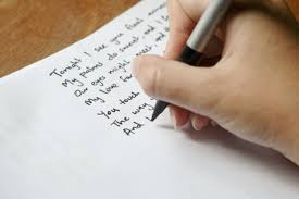 showing a hand writing a poem